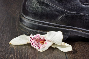 Boot crushes flower