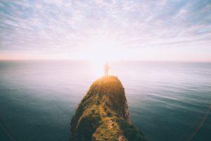 man on ocean rock