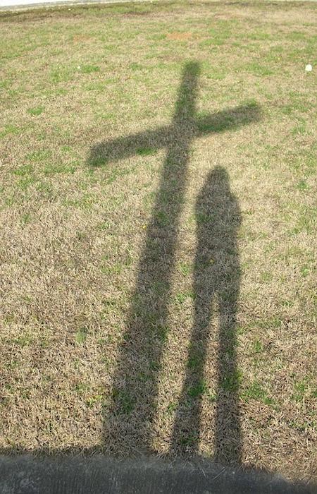 shadow-cross-on-grass